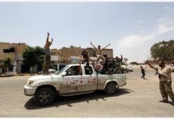 利比亚民族团结政府他自然能�蚩闯鲂�布收复首都的黎波里