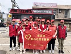 """南洋镇开展七彩的夏日""""烟头不落地""""创文志愿服务"""