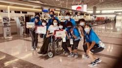 残奥会中国代表团第一批人员载誉回国